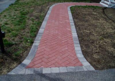 Hollandstone-Pavers-Herringbone-Pattern-in-Red-w-Brussels-Block-Half-Block-Border-in-Limestone