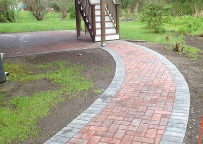 Hollandstone-Pavers-Herringbone Pattern-in-Terra-Cotta-w-Soldier-Course-Border-in-Granite
